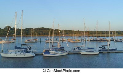 Aerial View of Yachts Moored in an Estuary at Sunset -...