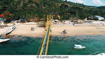 Aerial view of Yellow Bridge connecting Nusa Lembongan with Ceningan in Bali