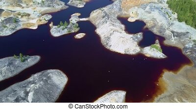 aerial view old clay quarry with flying birds on summer day...