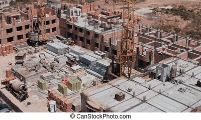 Aerial view on a construction site of the red bricks building