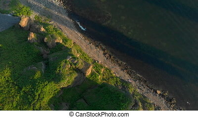 Aerial view on a sharp clffs by the sea shore
