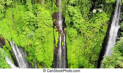 Aerial view on amazing waterfall on tropical island in Bali. slow motion.