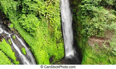 Aerial view on amazing waterfall on tropical island in Bali....