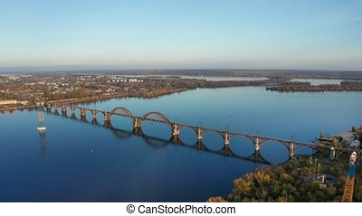 Aerial view on autumn landscape of railway bridge above...