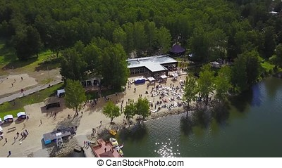 Aerial view on beautiful lake. Aerial view of river and beach in summer time. Lakeside beach with trees and sand view from the sky