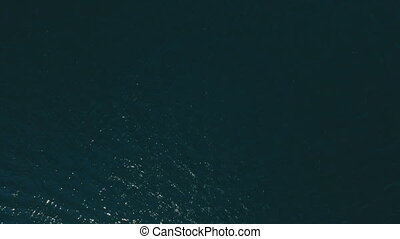 Aerial view on blue sea waves. Water background texture