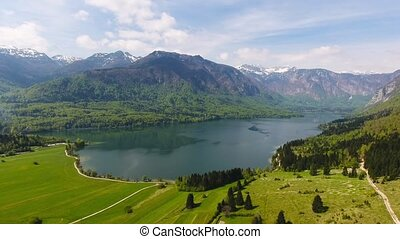 Bohinjsko jezero between mountains in Slovenia - Aerial view...