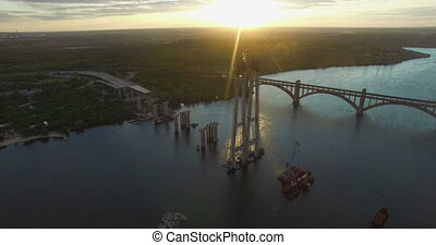 Aerial view on building new bridge over river