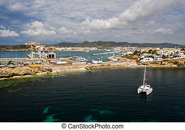 Aerial view on catamaran and port on the background.