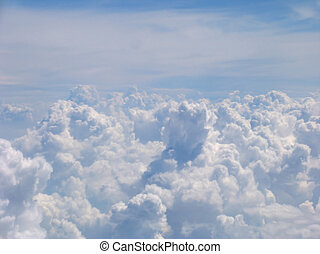Aerial view on clouds field from the bull's-eye of airplane