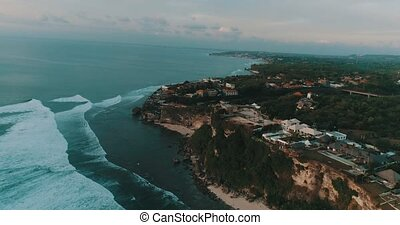 Aerial view on coastline, sea and waves. Drone view of an...