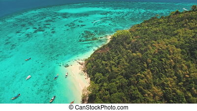 Aerial view on coral reef near tropic island with turquoise water. Boat tour tourist attraction. Travel destinations, outdoor tourism. Beautiful wild landscape. Exotic summer vacation. Drone flight