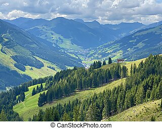 Aerial view on cozy hut with mountain panorama from Saalbach to Hinterglemm in the Alps in Austria on a sunny summer day