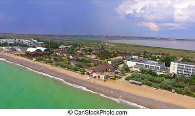 Aerial view on crimean coastline with beach and resort area