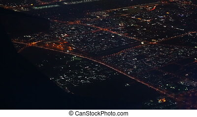 Aerial view on Dubai city from airplane at night