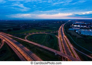 Aerial view on evening traffic on motorway junction