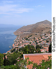 Aerial view on Greek city. sea and mountain