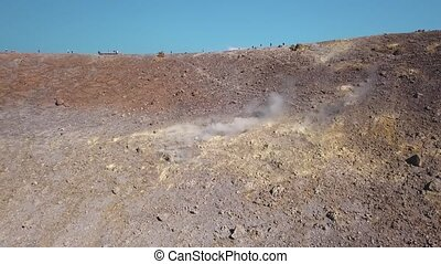 Aerial view on hot volcanic gas exiting through fumaroles on...