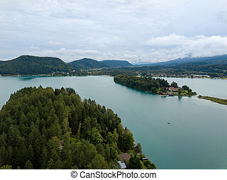 Aerial view on Lake 'Faaker See' in Carinthia (Kaernten), Austria with its famous turquoise water on a cloudy summer day