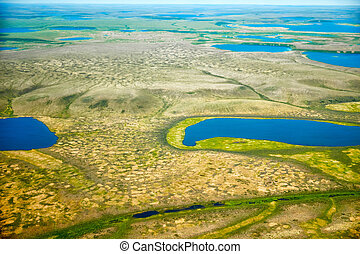 Aerial view on North Yakutia tundra landscapes from a plane