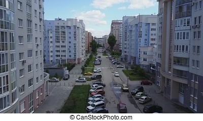 Aerial view on sleeping neighborhood in district with new houses. Business and culture concept - panoramic modern district skyline bird eye aerial view under dramatic sun and morning blue cloudy sky