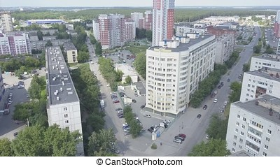 Aerial view on sleeping neighborhood in district with new houses. Business and culture concept - panoramic district skyline bird eye aerial view under dramatic sun and morning blue cloudy sky