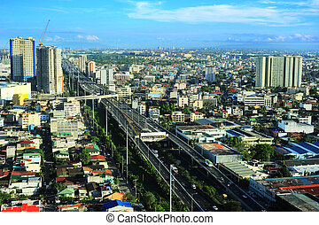 Metro Manila - Aerial view on slum and highway in Metro ...