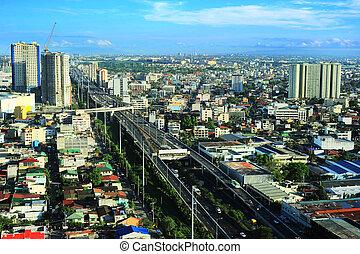 Metro Manila - Aerial view on slum and highway in Metro...