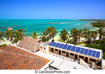 aerial view on the beach with a building with a solar panel on the Isla Contoy, Mexico