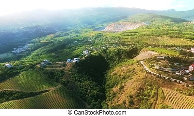 Aerial view on the beautiful landscape, sunshine in the mountains, forest and blue sky