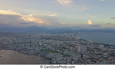Aerial view on the city of Nha Trang and river during sunset. Travel to Vietnam concept.