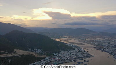 Aerial view on the city of Nha Trang and river during sunset...