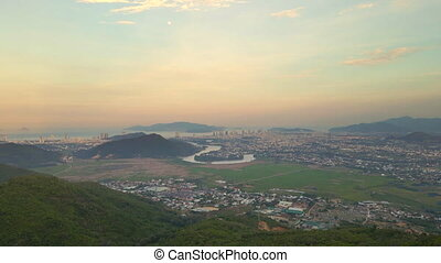 Aerial view on the city of Nha Trang shot from the northern part of the city. Beautiful sunset on the city and river