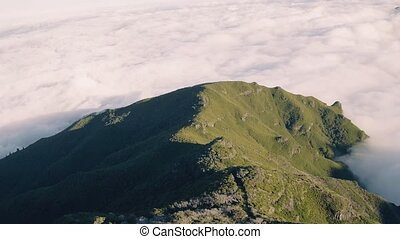 Aerial View on the Clouds from Top of Mountain
