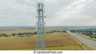 Aerial view on tower of cell phone antenna road with transportation and blue sky