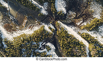 Aerial view on wild nature rural forest with lake and snow melting in spring
