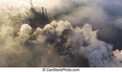 Aerial view over industrialized city. pollution from metallurgical plant. Dirty smoke and smog from pipes of steel factory and blast furnaces. Ecological