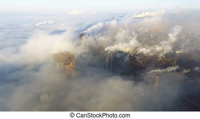 Aerial view over industrialized city. pollution from metallurgical plant.