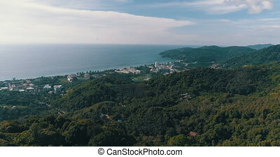 Aerial view over Phuket Hills and beaches - Ascending aerial...