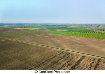 Aerial view over the agricultural fields spring time.