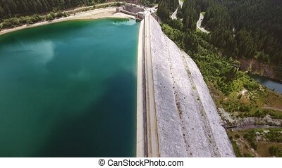 Aerial view over the dam of lake
