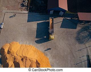 Aerial View Over The Grain Warehouse. Truck Unloads Corn Grain.