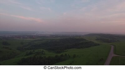Aerial View over the hills with smog at sunset. air...