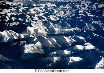 Aerial view over the rocky mountains from the airplane