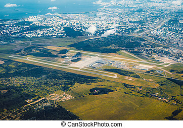 Aerial view over the runway approach at the airport.