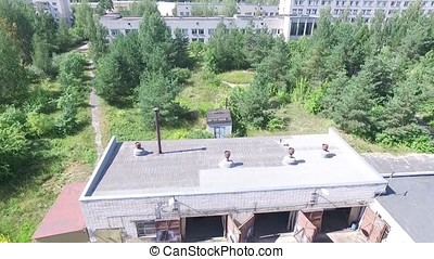 Aerial view over the small town. Aerial survey of buildings...
