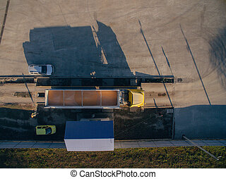 Aerial View Over The Truck. Unloading of Corn Grain in the Warehouse.