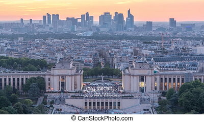 Aerial view over Trocadero day to night timelapse with the Palais de Chaillot seen from the Eiffel Tower in Paris, France.