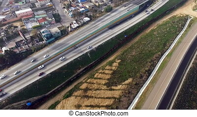 Aerial View Pan Up Fence Highway Border Mexico Tijuana - The...