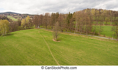 Aerial View. Panorama over a green grassy in mountains.